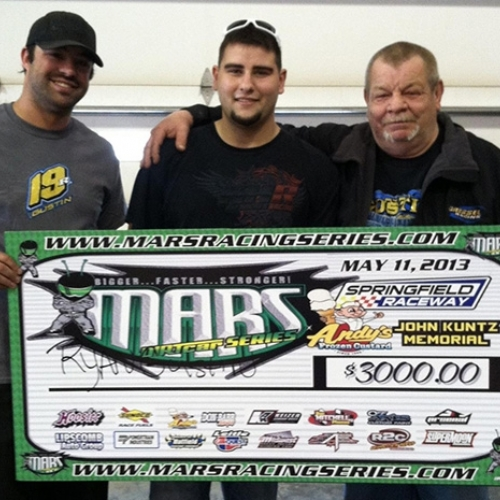 Left to right: Crew chief Zach Gossett, driver Ryan Gustin and car owner Ed Gressel hold the check after winning their first dirt late model event at the Springfield Raceway on Saturday, May 11.