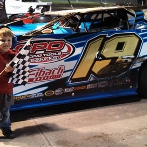 Penny Lehner's grandson, Cullin, in the pits at the Adams County Speedway in Corning, Iowa, on Saturday, June 29.